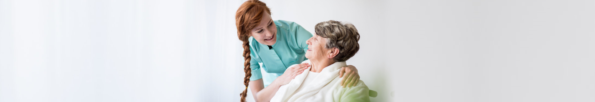 nurse talking with a senior