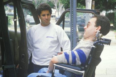 man getting inside the car